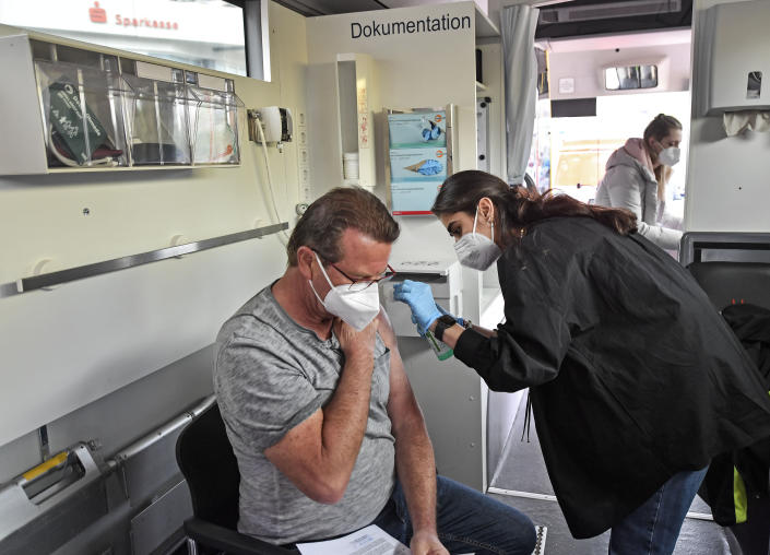 Harald Fischer gets a Moderna vaccination in a vaccination mobile on a square at the district Chorweiler in Cologne, Germany, Monday, May 3, 2021. The city of Cologne started a program to bring COVID-19 vaccination to people living in this neighborhood with a high corona incidence. (AP Photo/Martin Meissner)