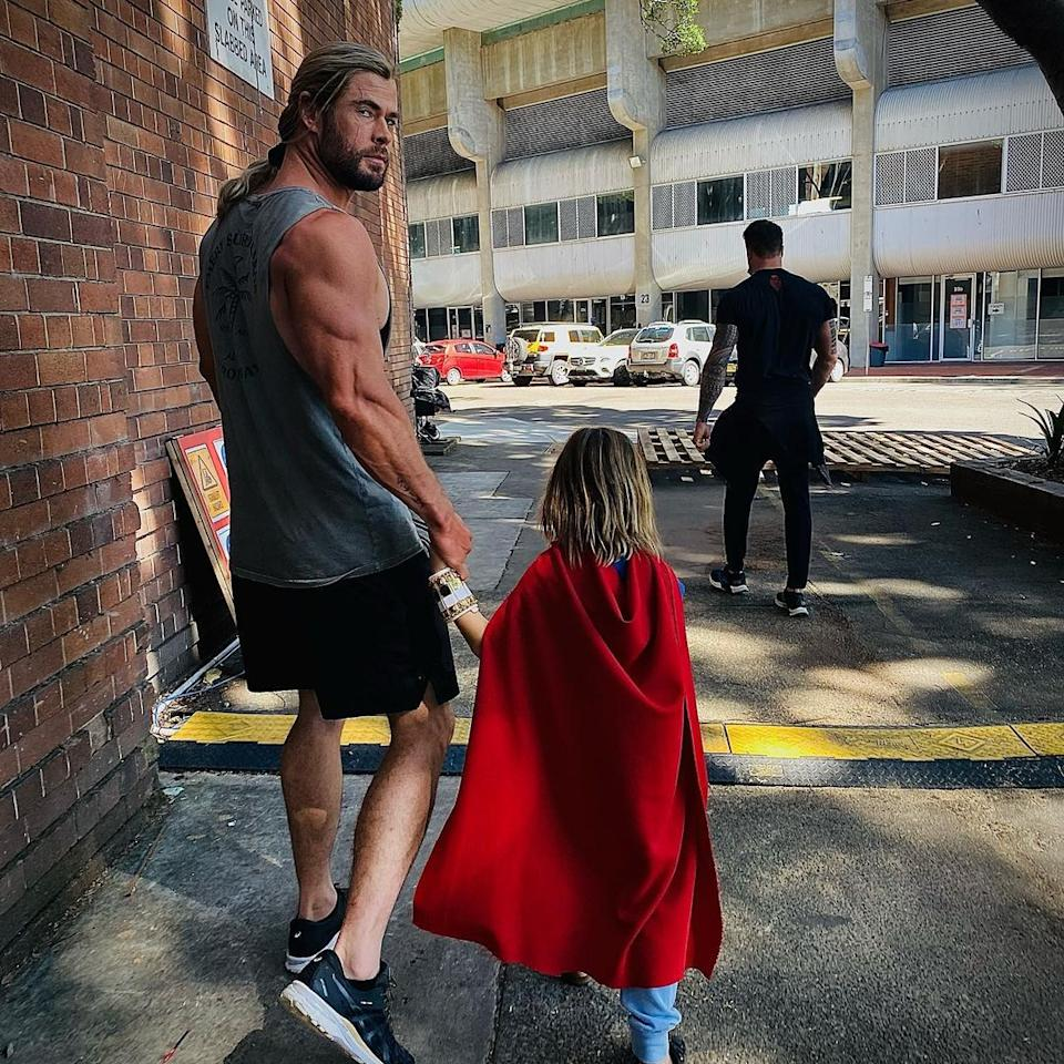 Chris Hemsworth and his son holding hands