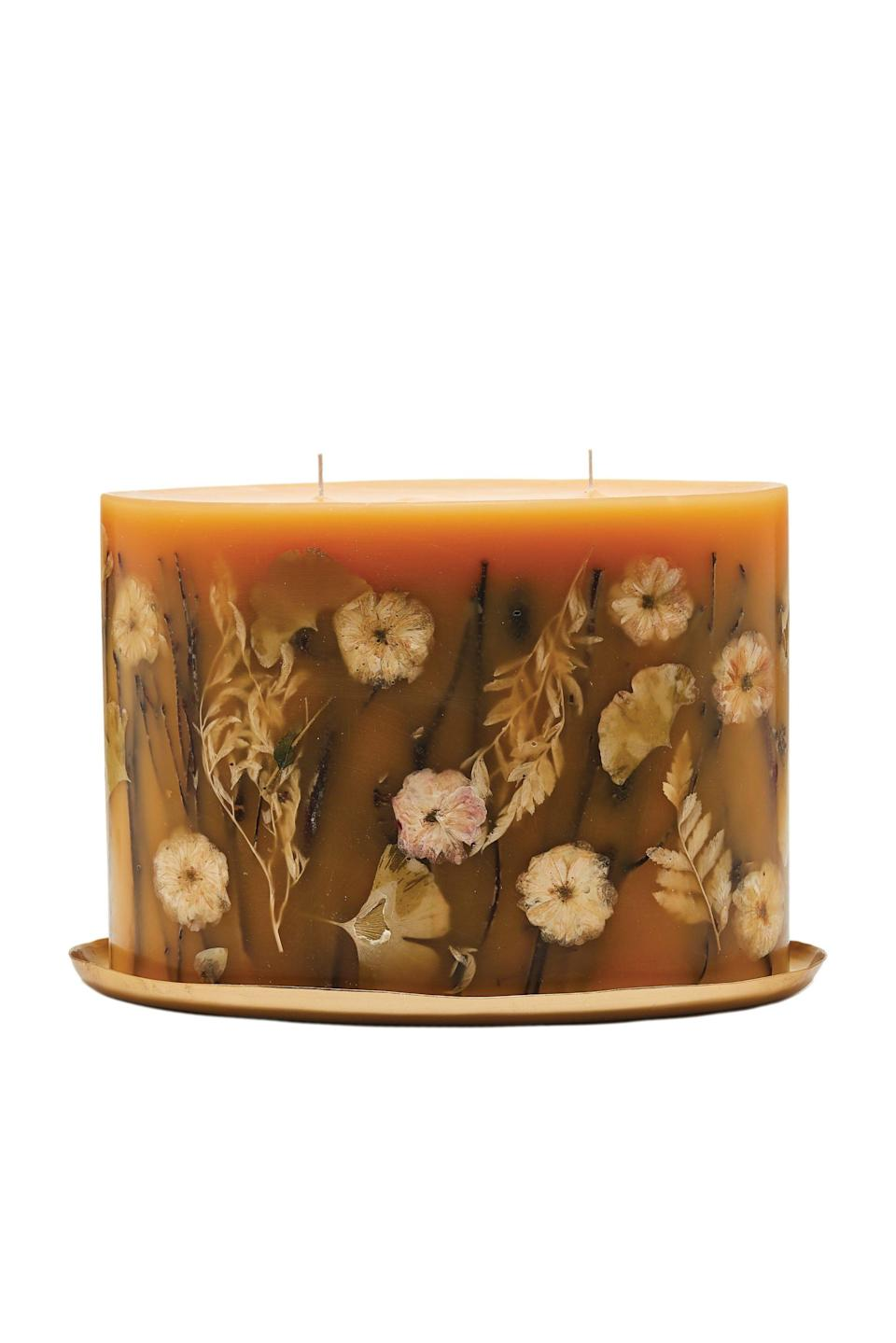 """<p><strong>Rosy Rings</strong></p><p>rosyrings.com</p><p><strong>$220.00</strong></p><p><a href=""""https://rosyrings.com/product/honey-tobacco-limited-botanical-candle-plate-set/"""" rel=""""nofollow noopener"""" target=""""_blank"""" data-ylk=""""slk:Shop Now"""" class=""""link rapid-noclick-resp"""">Shop Now</a></p><p>""""I can't get enough of Rosy Rings' botanical candles—when lit, they look like mini art pieces on my coffee table. Though I want to try every scent, I always go back to the cozy Honey Tobacco.""""—<em>Julie Kosin, senior culture editor</em></p>"""