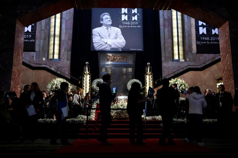Fans line up to pay tribute to late Mexican singing legend Jose Jose at the Palace of Fine Arts in Mexico City on October 9, 2019