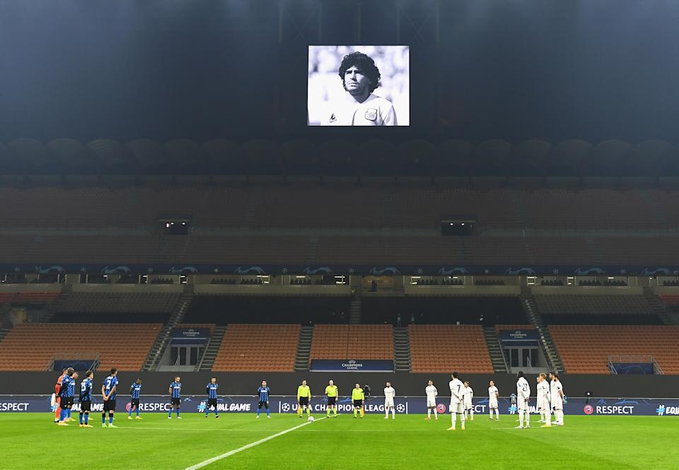 Inter Milan and Real Madrid players in a minute of silence in tribute to Diego Maradona before their Champions League match at the San Siro Stadium in Milan. (PHOTO: Claudio Villa - Inter/Inter via Getty Images)
