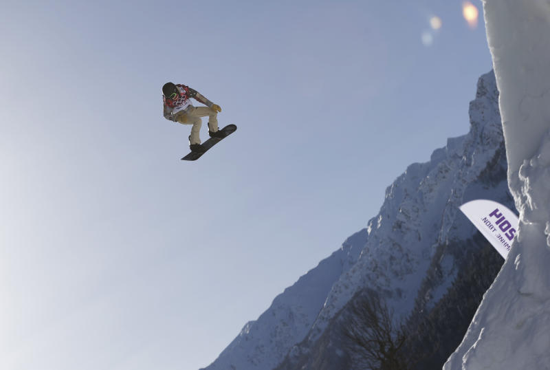 FILE - In this Tuesday, Feb. 4, 2014 file photo, Shaun White of the United States takes a jump during a Snowboard Slopestyle training session at the Rosa Khutor Extreme Park in Krasnaya Polyana, Russia, prior to the 2014 Winter Olympics. White said Wednesday, Feb. 5, that he is pulling out of the Olympic slopestyle contest to focus solely on winning a third straight gold medal on the halfpipe. (AP Photo/Andy Wong, File)