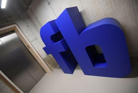 A giant logo is seen at Facebook's headquarters in London