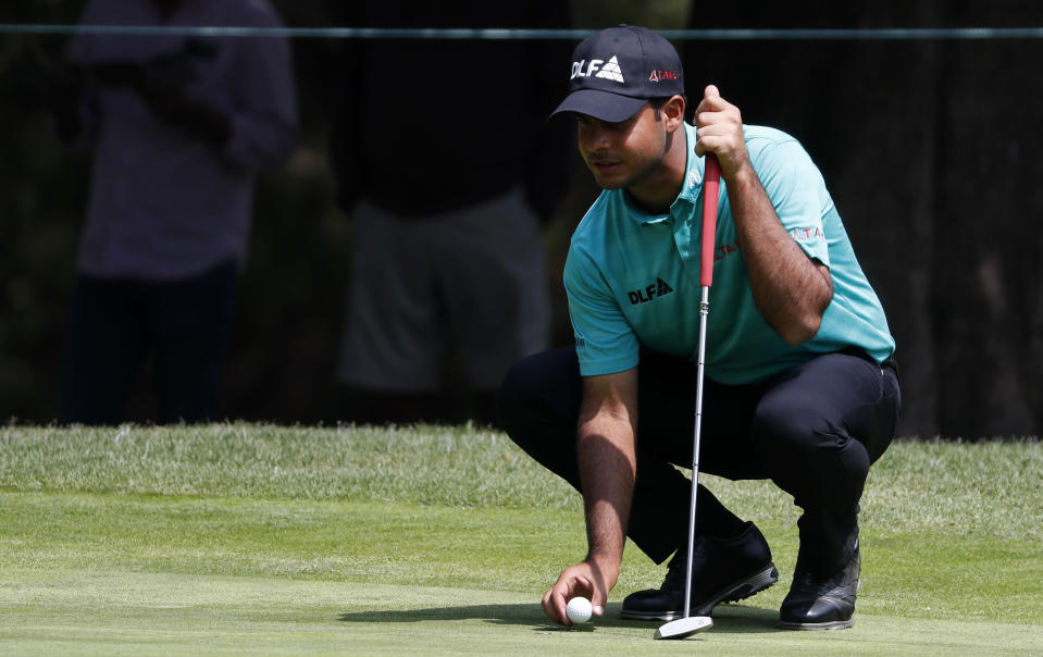 India's Shubhankar Sharma squats down at the 7th hole during the second round of the Mexico Championship at the Chapultepec Golf Club in Mexico City, Friday, March 2, 2018. (AP Photo/Eduardo Verdugo)