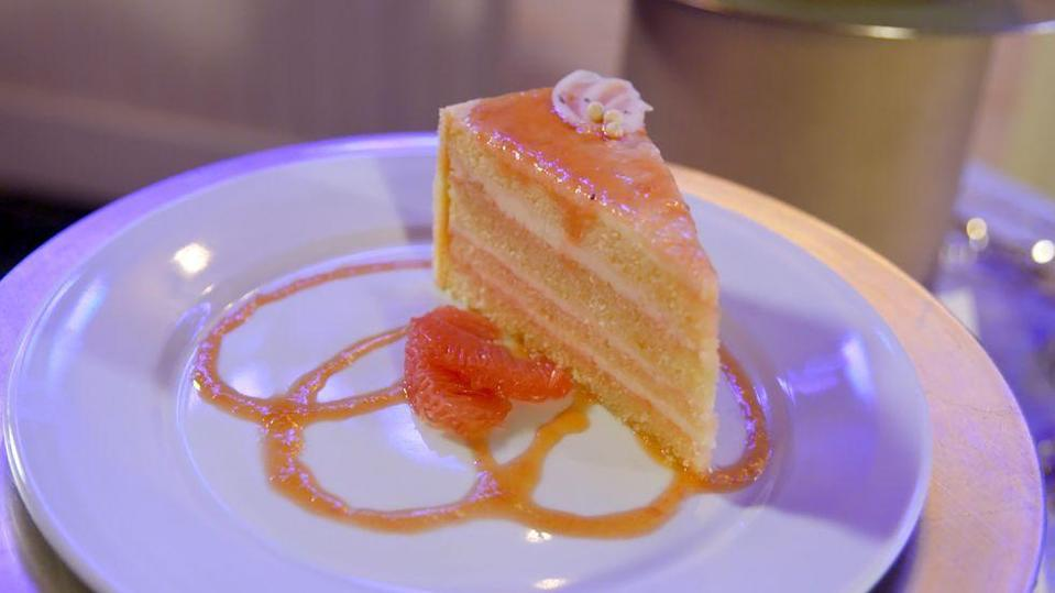 <p>Another dish that was popular because of The Brown Derby association was the Grapefruit Cake. Made with vanilla sponge cake, grapefruit syrup, grapefruit cheesecake, and grapefruit jam, this dish's popularity spiked super high at Disney. </p>
