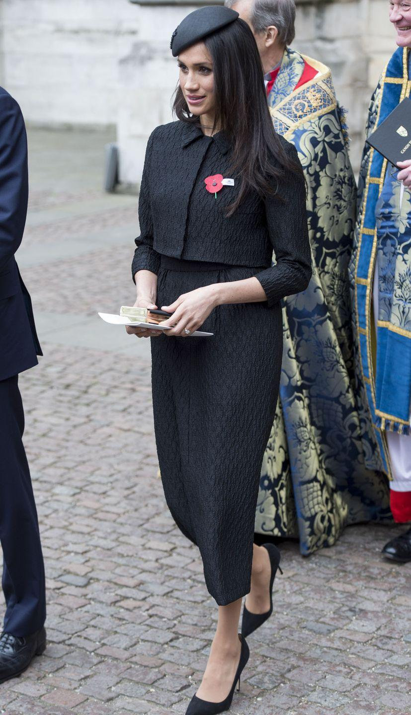 """<p>Later on Anzac day, Markle looked timeless in a bespoke <a class=""""link rapid-noclick-resp"""" href=""""https://www.matchesfashion.com/womens/designers/emilia-wickstead"""" rel=""""nofollow noopener"""" target=""""_blank"""" data-ylk=""""slk:Emilia Wickstead"""">Emilia Wickstead</a> black, jacquard midi skirt and cropped matching jacket at Westminster Abbey </p>"""