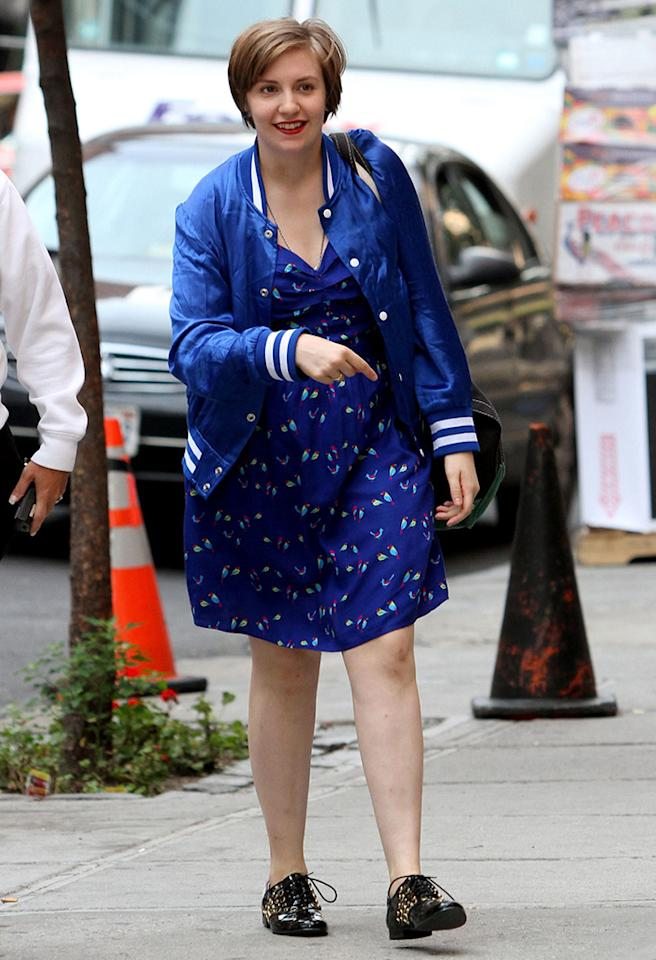 "<b>Who:</b> Lena Dunham<br /><br /><b>Wearing:</b> A blue satin jacket and matching muumuu<br /><br /><b>Where:</b> Heading to the set of ""Girls"" in NYC"