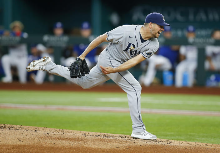 Tampa Bay Rays starting pitcher Rich Hill (14) throws during the first inning of a baseball game against the Texas Rangers, Saturday, June 5, 2021, in Arlington, Texas. (AP Photo/Brandon Wade)
