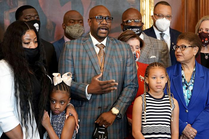 """Philonise Floyd, the brother of George Floyd, speaks as he and members of the Floyd family meet with House Speaker Nancy Pelosi and Rep. Karen Bass in the Rayburn Room of the Capitol in Washington, on May 25, 2021.<span class=""""copyright"""">Greg Nash—Pool/AFP/Getty Images</span>"""