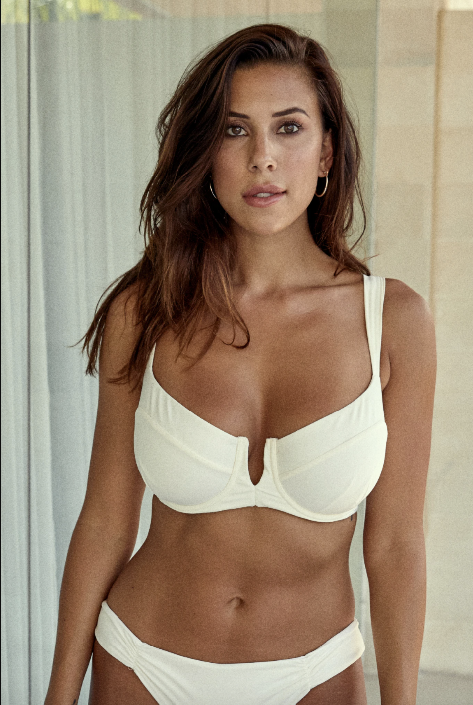 "<p><strong>Monday Swimwear</strong></p><p>mondayswimwear.com</p><p><strong>$94.00</strong></p><p><a href=""https://mondayswimwear.com/collections/styles-for-cup-sizes-e-g/products/clovelly-top-ivory-sig"" rel=""nofollow noopener"" target=""_blank"" data-ylk=""slk:Shop Now"" class=""link rapid-noclick-resp"">Shop Now</a></p><p>Monday Swimwear features ""iconic feminine designs"" that are stylish and sexy. Fitting cup sizes B-E<strong>, this top offers a comfy, supportive fit </strong>for those with a larger bust. This best-selling style is available in ten shades and patterns including soft neutrals and cheetah print. Reviewers recommend checking out the brand's <a href=""https://mondayswimwear.com/pages/fit-guide-2019#tops"" rel=""nofollow noopener"" target=""_blank"" data-ylk=""slk:size guide"" class=""link rapid-noclick-resp"">size guide</a> to determine your perfect fit. </p>"