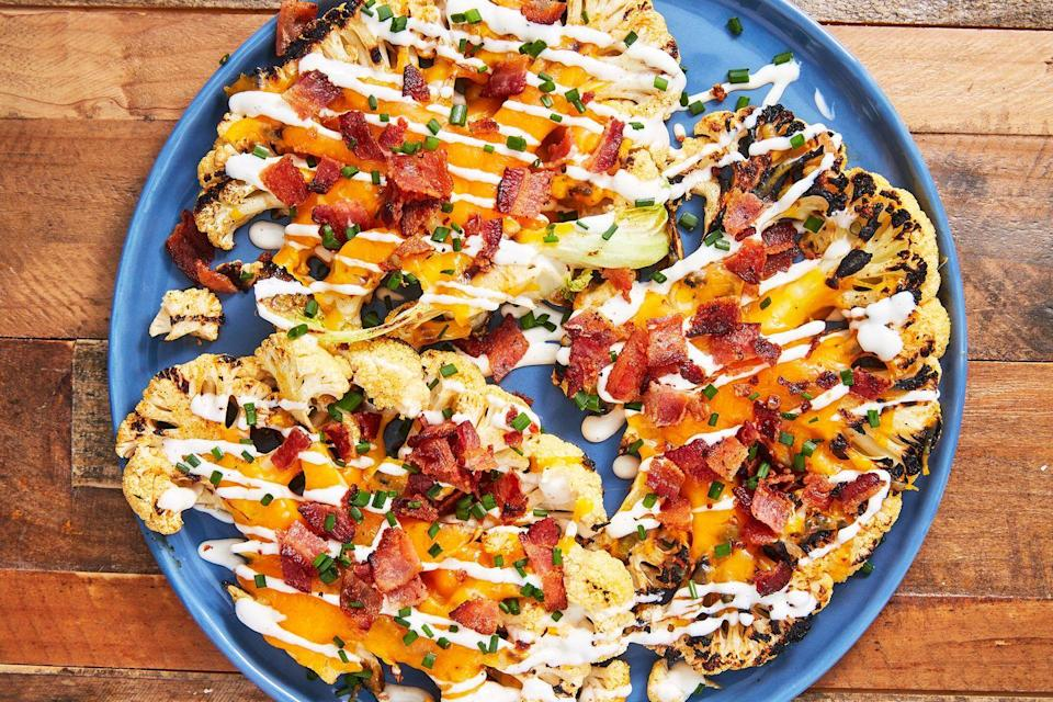 """<p>No need for a potato—cauliflower does the job even better!<br></p><p>Get the recipe from <a href=""""https://www.delish.com/cooking/recipe-ideas/recipes/a54879/loaded-grilled-cauliflower-recipe/"""" rel=""""nofollow noopener"""" target=""""_blank"""" data-ylk=""""slk:Delish"""" class=""""link rapid-noclick-resp"""">Delish</a>.</p>"""