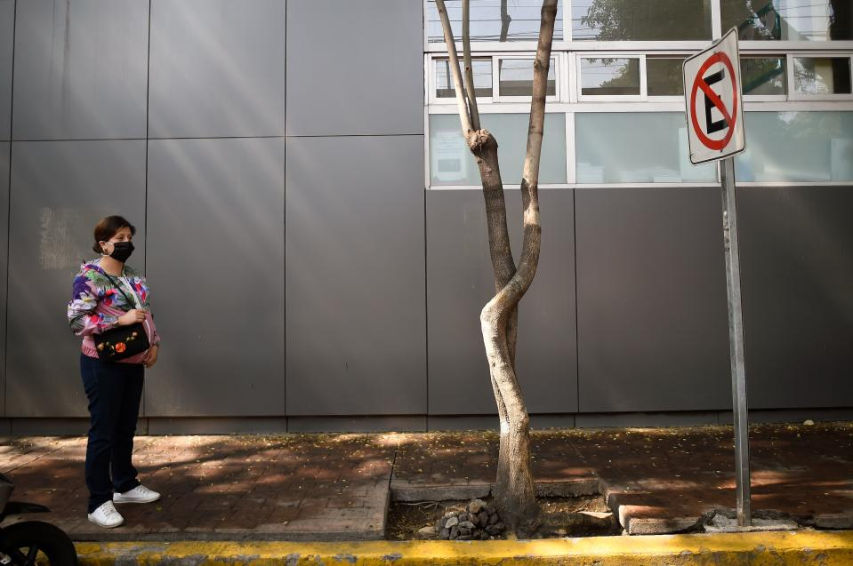 A pregnant woman stays outside the Tacuba General Hospital in Mexico City on April 21, 2020. - Mexico raised its health emergency level following a rapid increase in coronavirus cases and amid fears the health system could collapse, the government said Tuesday. (Photo by ALFREDO ESTRELLA / AFP) (Photo by ALFREDO ESTRELLA/AFP via Getty Images)