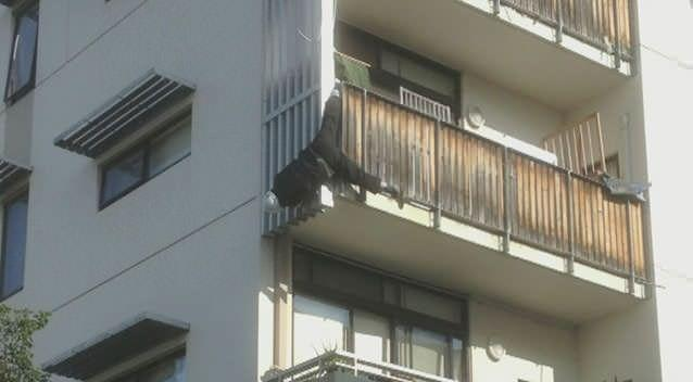 Firefighters were called to rescue a tradesman who was left dangling from a balcony for half an hour. Supplied