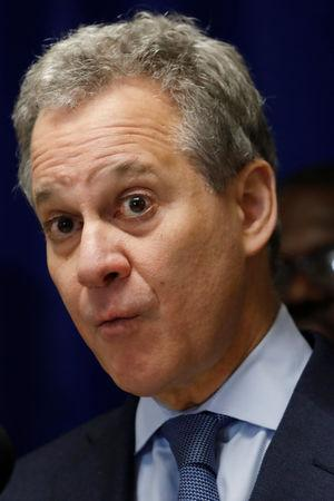 FILE PHOTO: New York State Attorney General Eric T. Schneiderman speaks at a news conference during a community gun buy-back program in White Plains, New York, U.S., April 13, 2018. REUTERS/Shannon Stapleton/File Photo