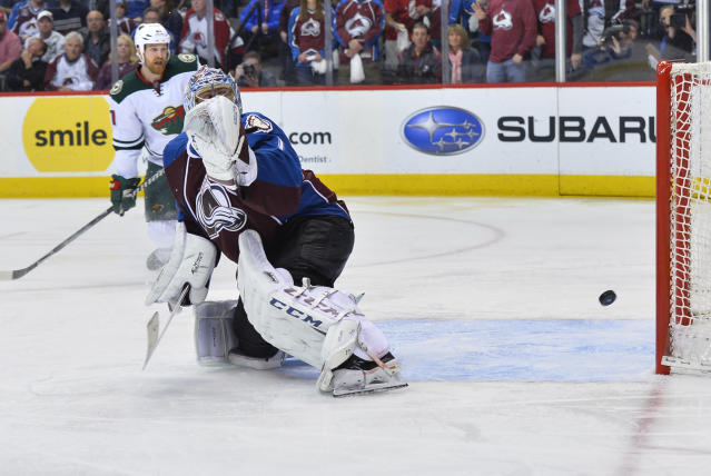 Colorado Avalanche goalie Semyon Varlamov, right, of Russia lets the winning goal slip past off the stick of Minnesota Wild right wing Nino Niederreiter of Switzerland as Kyle Brodziak, back, stands near in the overtime period during Game 7 of an NHL hockey first-round playoff series on Wednesday, April 30, 2014, in Denver. Minnesota won 5-4 to win the series. (AP Photo/Jack Dempsey)