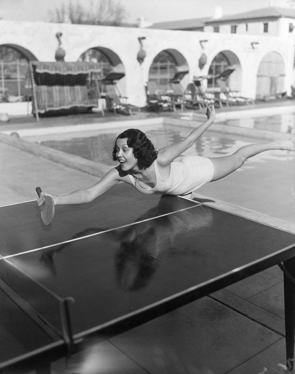 <p>The <em>Duck Soup</em> comedy starlet leans over the table while fully committing to her ping pong game on December 12, 1932. </p>
