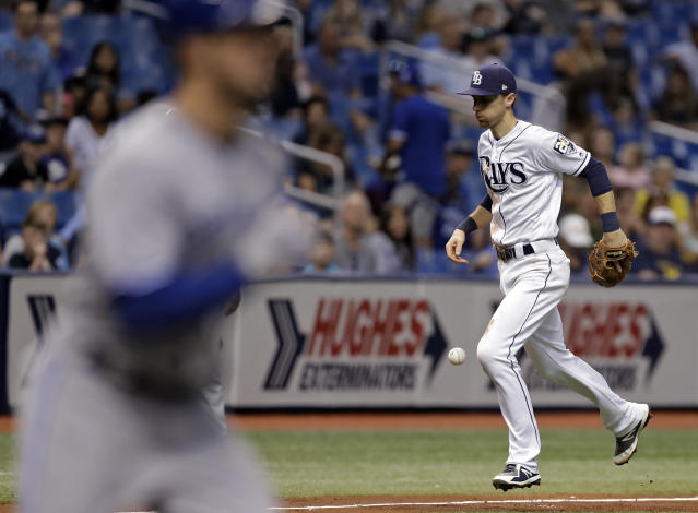 Tampa Bay Rays third baseman Matt Duffy can't hang on to an infield single by Toronto Blue Jays' Randal Grichuk during the fifth inning of a baseball game Tuesday, June 12, 2018, in St. Petersburg, Fla. (AP Photo/Chris O'Meara)