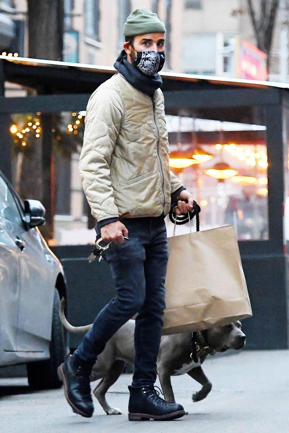 <p>Justin Theroux and pup Kuma make some last-minute pre-holiday stops in N.Y.C. on Tuesday.</p>