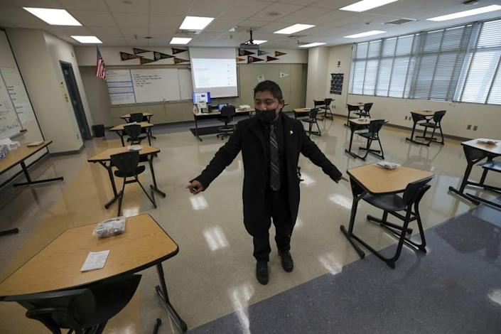Panorama City, CA - March 10: English teacher Elmer Garcia describes when schools will reopen seats in a classroom will set at least 6-feet apart at Panorama High School on Wednesday, March 10, 2021 in Panorama City, CA.(Irfan Khan / Los Angeles Times)