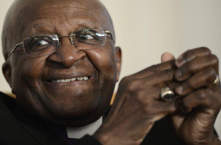 """South Africa's Nobel Peace Laureate Archbishop Desmond Tutu takes part in a meeting seeking to end child marriages in sub-Saharan Africa on November 6, 2012 in Johannesburg. Tutu said Tuesday he hoped to see a """"truly free"""" Myanmar as he met fellow Nobel Peace Prize winner Aung San Suu Kyi during a visit to the former junta-ruled nation"""