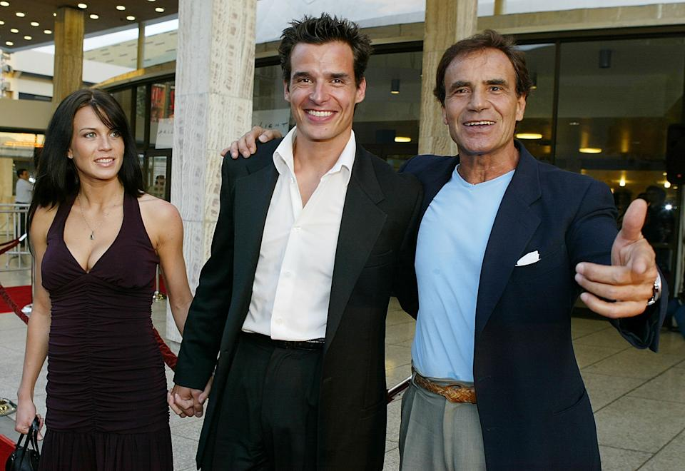 Actor Antonio Sabato Jr. (C), his father Antonio Sabato Sr. and girlfriend Kristin Rosetti arrive for the premiere of the movie Wasabi Tuna at the Arclight Theater August 20, 2003 in Hollywood, California.  (Photo by Carlo Allegri/Getty Images)