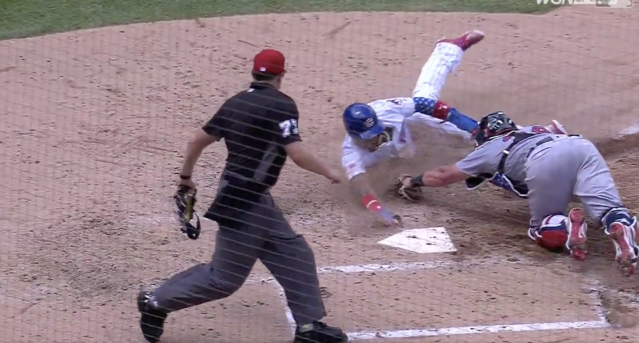 Javy Baez pulls off a steal of home using his signature slide. (MLB.com)