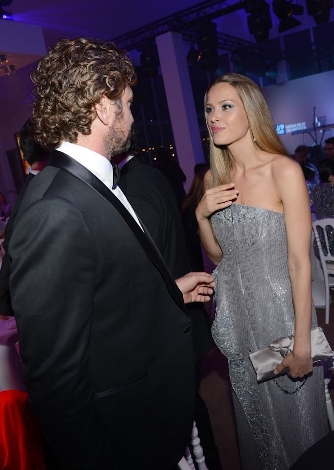 CANNES, FRANCE - MAY 18:  Actor Gerard Butler (L) and model Petra Nemcva attend the Haiti Carnival in Cannes Benefitting J/P HRO, Artists for Peace and Justice & Happy Hearts Fund Presented By Armani during the 65th Annual Cannes Film Festival on May 18, 2012 in Cannes, France.  (Photo by Michael Buckner/Getty Images)