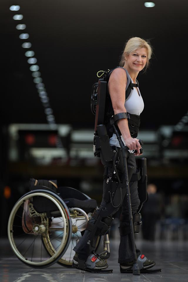 LONDON, ENGLAND - OCTOBER 21:  Amanda Boxtel, who is paralysed, is helped to walk with the aid of the new 'Bionic Exoskeleton' during its launch at the Excel centre on October 21, 2011 in London, England. The device developed by Ekso Bionics is a wearable, battery-powered, robotic exoskeleton, designed to aid wheelchair users and those who have suffered from spinal chord injuries to stand and walk.  (Photo by Dan Kitwood/Getty Images)