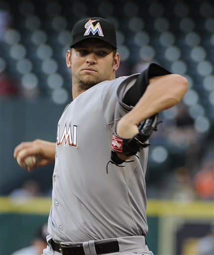 Miami Marlins' Josh Johnson winds up to pitch against the Houston Astros in the first inning of a baseball game on Wednesday, May 9, 2012, in Houston. (AP Photo/Pat Sullivan)