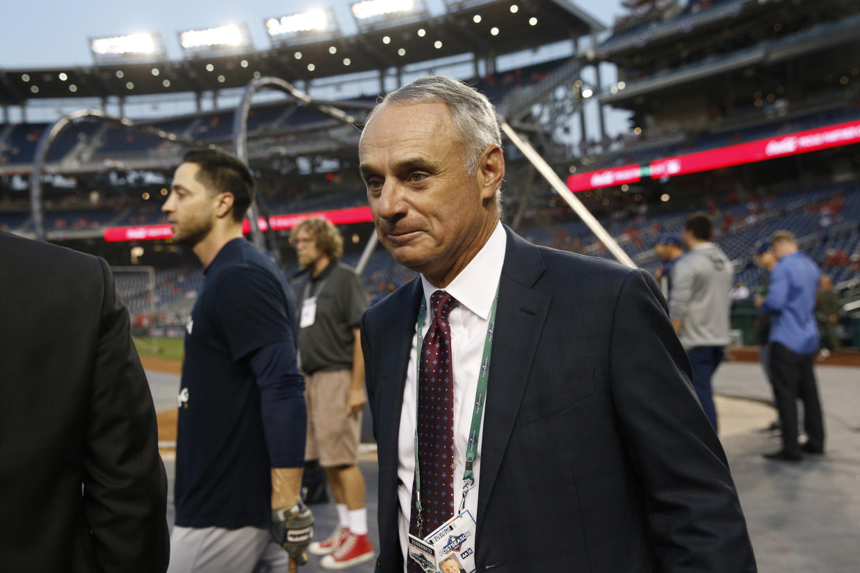 Commissioner of Major League Baseball Rob Manfred walks on the field during batting practice before a National League wild card baseball game between the Milwaukee Brewers and the Washington Nationals, Tuesday, Oct. 1, 2019, in Washington. (AP Photo/Patrick Semansky)