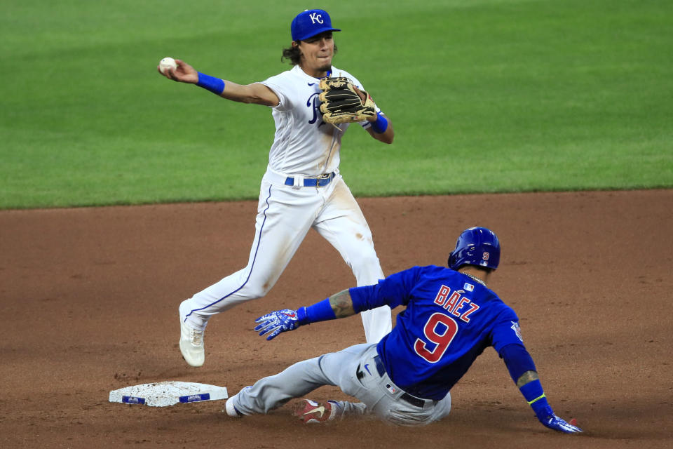 Kansas City Royals second baseman Nicky Lopez (1) turns a double play over the top of Chicago Cubs Javier Baez (9) during the fourth inning of a baseball game at Kauffman Stadium in Kansas City, Mo., Wednesday, Aug. 5, 2020. Chicago Cubs Anthony Rizzo was out at first and a run scored on the play. (AP Photo/Orlin Wagner)