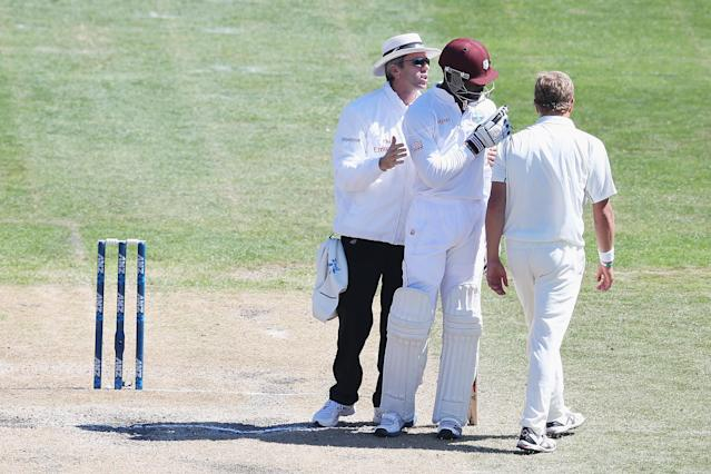 DUNEDIN, NEW ZEALAND - DECEMBER 05: Neil Wagner of New Zealand confronts Kirk Edwards of the West Indies during day three of the first test match between New Zealand and the West Indies at University Oval on December 5, 2013 in Dunedin, New Zealand. (Photo by Hannah Johnston/Getty Images)