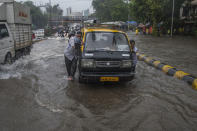 MUMBAI, INDIA - JULY 16: People push the taxi in the waterlogged street due to heavy rain at Gandhi Market, sion, on July 16, 2020 in Mumbai, India. (Photo by Pratik Chorge/Hindustan Times via Getty Images)