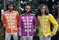 """<p>Originally from England, the Gibb family immigrated to Australia, where the three boys, Barry, Robin and Maurice, had moderate success with their music on Australian TV shows. The family moved back to England in 1967 to help further their careers but the brothers split briefly after the failure of their 1969 album. They reunited to release their first #1 hit, """"<a href=""""https://www.amazon.com/How-Can-Mend-Broken-Heart/dp/B01NALMO7C/?tag=syn-yahoo-20&ascsubtag=%5Bartid%7C10055.g.33861456%5Bsrc%7Cyahoo-us"""" rel=""""nofollow noopener"""" target=""""_blank"""" data-ylk=""""slk:&quot;How Can You Mend a Broken Heart&quot;"""" class=""""link rapid-noclick-resp"""">""""How Can You Mend a Broken Heart""""</a>"""" in 1971, which also earned a Grammy nomination. This was followed by other hits including <a href=""""https://www.amazon.com/Lonely-Days/dp/B01MZ27YJV/?tag=syn-yahoo-20&ascsubtag=%5Bartid%7C10055.g.33861456%5Bsrc%7Cyahoo-us"""" rel=""""nofollow noopener"""" target=""""_blank"""" data-ylk=""""slk:""""Lonely Days."""""""" class=""""link rapid-noclick-resp"""">""""Lonely Days.""""</a> Their fame temporarily slowed, but they experienced a resurgence in the mid-70s. With exquisite three-part harmonies, the group has had more #1 singles than any band but the Beatles.</p>"""
