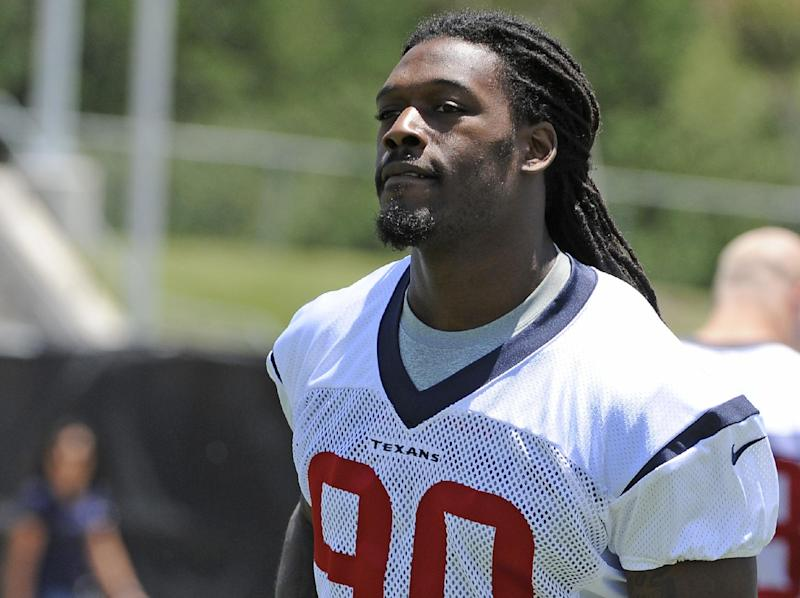 Houston Texans first round draft pick Jadeveon Clowney takes the field for NFL football rookie camp Friday, May 16, 2014, in Houston