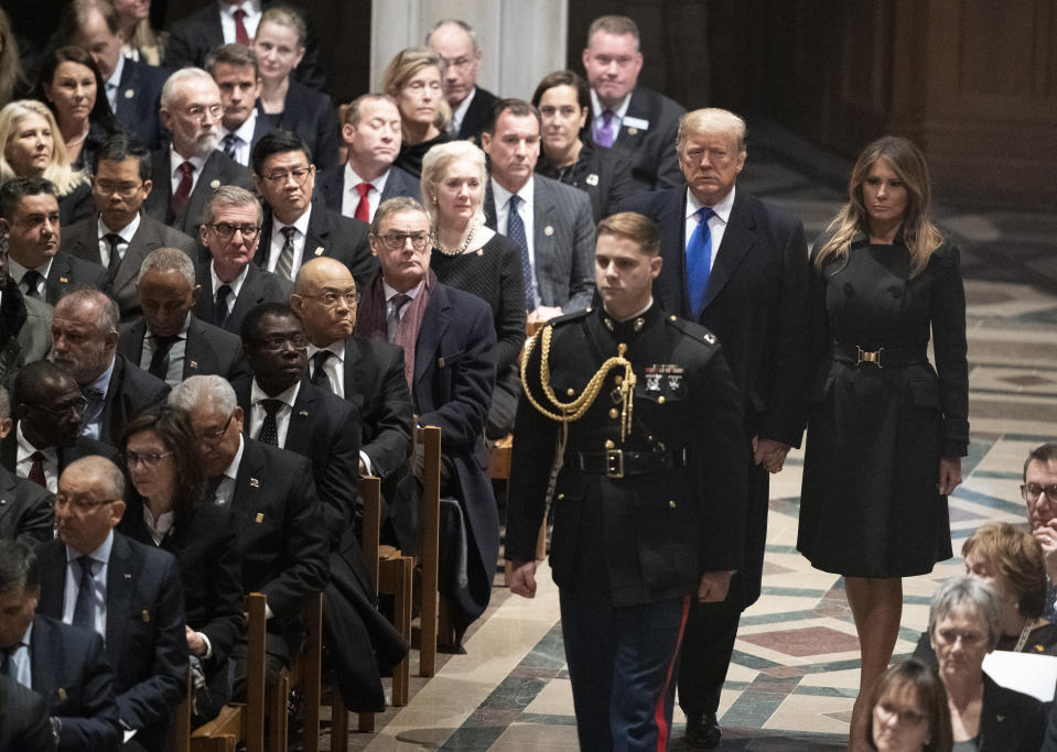 President Donald Trump and first lady Melania Trump arrive for the State Funeral for former President George H.W. Bush at the Washington National Cathedral in Washington, Wednesday, Dec. 5, 2018. (Photo: Carolyn Kaster/AP)