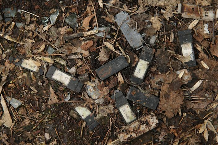 <p>Small dosimeters that measure radiation dosage and used by emergency workers following the Chernobyl nuclear disaster lie scattered on the ground (Getty Images) </p>