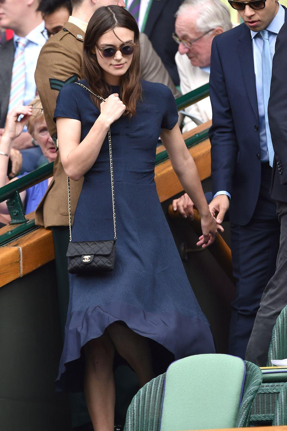 <p><strong>2014</strong> Keira Knightley was stylish in a simple blue midi-dress and a Chanel bag.</p>