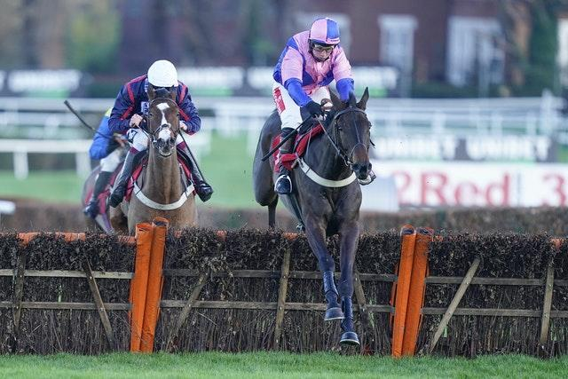 Hudson de Grugy ridden by Jamie Moore, right, clears the last to win The Unibet Extra Place Races Every Day Juvenile Hurdle at Sandown Park