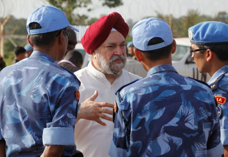 FILE PHOTO: U.N. Security Council member Ambassador Hardeep Singh Puri of India speaks with Indian MINUL soldiers in Liberia
