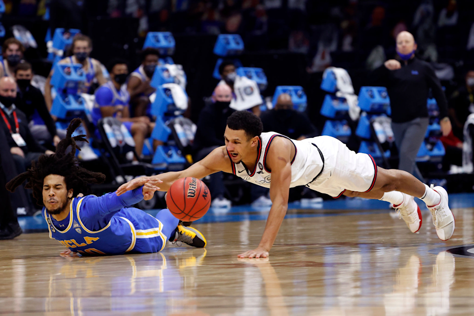 UCLA's Tyger Campbell, left, and Gonzaga's Jalen Suggs battle for a loose ball during the NCAA Final Four in April.