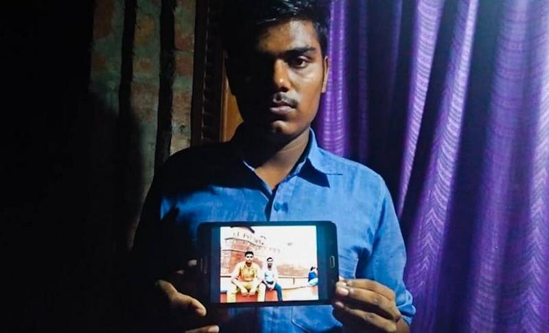 Krishan Yadav holds a picture of his cousin Pankaj who died while trying to clean a septic tank at DLF Capital Greens' residential complex in Moti Nagar. Pallavi Rebbapragada