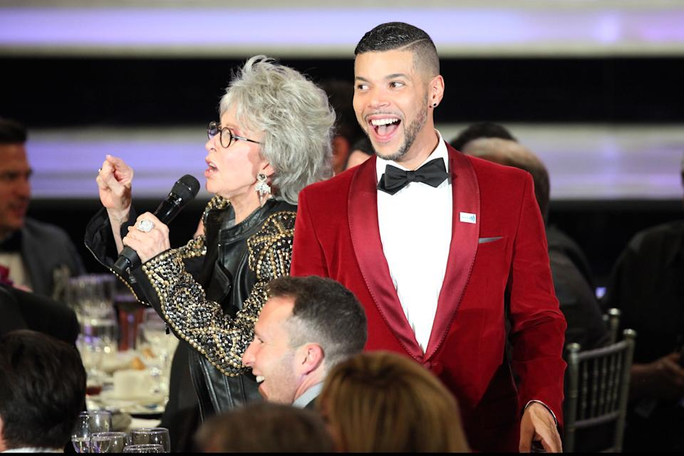 BEVERLY HILLS, CA - APRIL 12:  Actors Wilson Cruz (R) and Rita Moreno onstage during the 25th Annual GLAAD Media Awards at The Beverly Hilton Hotel on April 12, 2014 in Los Angeles, California.  (Photo by Gabriel Olsen/Getty Images)