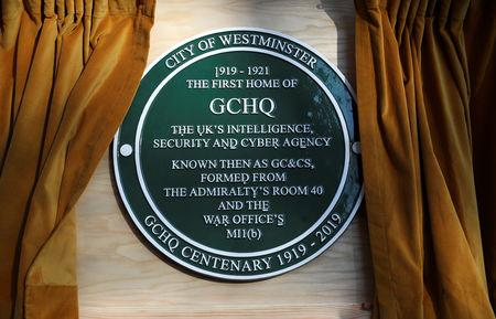 A GCHQ plaque is seen during Britain's Queen Elizabeth's visit at the Watergate House to mark the centenary of the GCHQ (Government Communications Head Quarters) in London, Britain, February 14, 2019. REUTERS/Hannah McKay/Pool