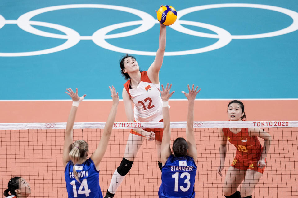 China's Li Yingying spikes the ball during a women's volleyball preliminary round pool B match between China and Russian Olympic Committee at the 2020 Summer Olympics, Thursday, July 29, 2021, in Tokyo, Japan. (AP Photo/Manu Fernandez)