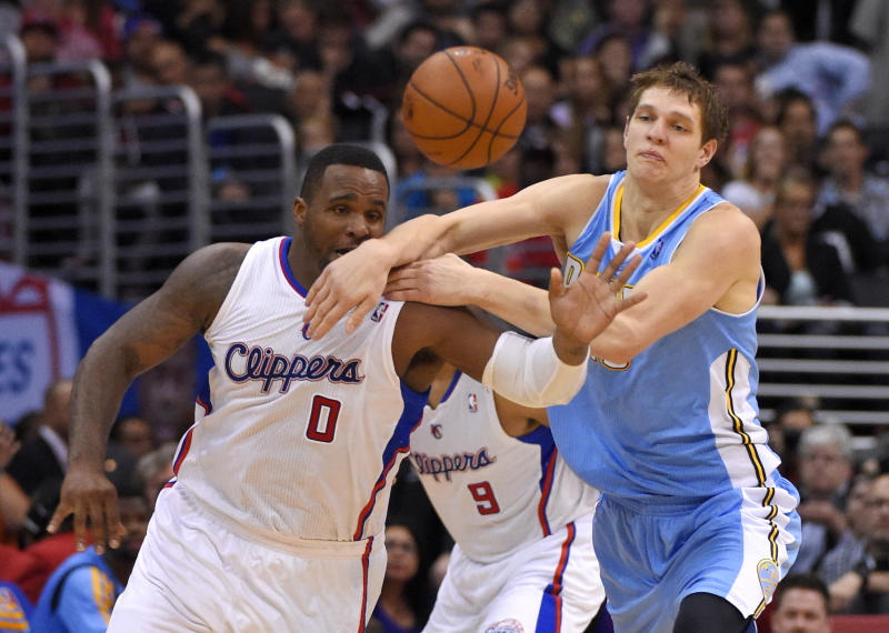 Los Angeles Clippers forward Glen Davis, left, and Denver Nuggets center Timofey Mozgov, of Russia, compete for a loose ball during the first half of an NBA basketball game, Tuesday, April 15, 2014, in Los Angeles. (AP Photo/Mark J. Terrill)