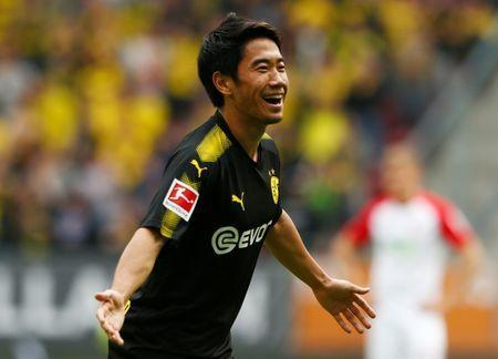 Soccer Football - Bundesliga - FC Augsburg vs Borussia Dortmund - Augsburg Arena, Augsburg, Germany - September 30, 2017 Borussia Dortmund's Shinji Kagawa celebrates scoring their second goal REUTERS/Michaela Rehle