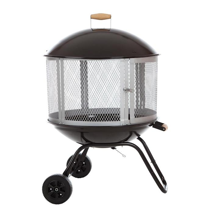 """This wood-burning fire pit has wheels and a handle grip, making it a breeze to transport. The bowl and lid are porcelain, and the grate, which gives a 360-degree view of the flames, is steel. $138, BBQ Guys. <a href=""""https://www.bbqguys.com/fire-sense/bon-fire-28-inch-wood-burning-fire-pit-black-1471"""" rel=""""nofollow noopener"""" target=""""_blank"""" data-ylk=""""slk:Get it now!"""" class=""""link rapid-noclick-resp"""">Get it now!</a>"""