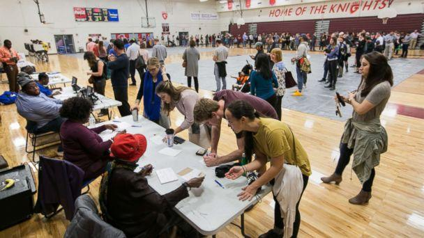 PHOTO: Voters line up to cast their ballots at a polling station set up at Grady High School for the mid-term elections, Nov. 6, 2018 in Atlanta. (Jessica McGowan/Getty Images)