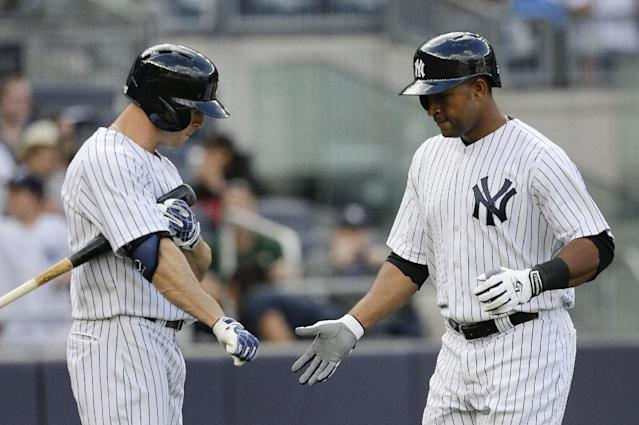 New York Yankees' Zoilo Almonte , right, is greeted at home plate by Brett Gardner after hitting a solo home run against the Pittsburgh Pirates during the third inning of a baseball game, Saturday, May 17, 2014, in New York. (AP Photo/Julie Jacobson)